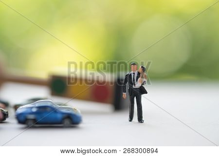 Closeup Image Of Miniature Father Carrying His Infant Baby Boy And Walking Together With Blur Backgr