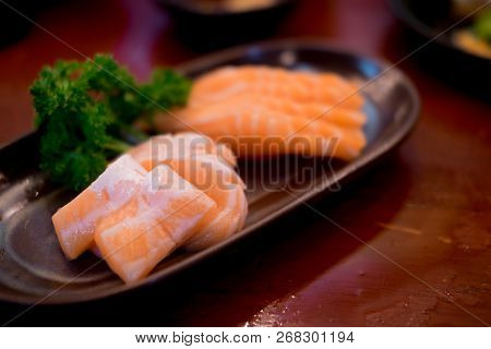 Raw Salmons Fillet On Dish In Restaurant, Japanese Food Style, Selective Focus