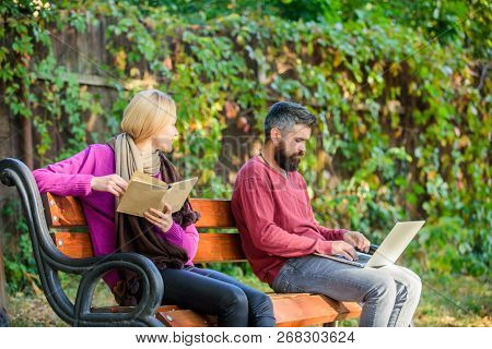Couple Spend Leisure Reading. Couple With Book And Laptop Search Information. Use Digital Approach A