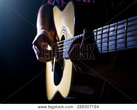 Guitarist Plays On The Acoustic Guitar On The Stage.