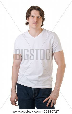 Handsome muscular man wearing white t-shirt and blue jeans against white background