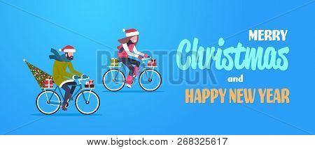 Couple Woman Man Riding Bike With Fir Tree Gift Box Merry Christmas Happy New Year Concept Flat Hori