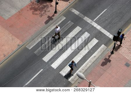 Crosswalk With Several People, Crosswalk On The Street, Pedestrian Crossing In The City