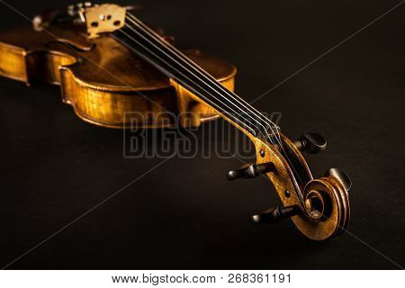 Close Up Of A Violin Against A Black Background
