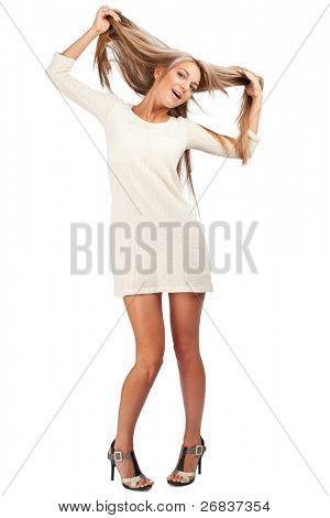 Full length portrait of young cheerful woman pulling her hair, against white background