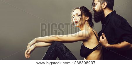 Young Couple Of Pretty Sexy Woman In Black Jeans And Bra Has Slim Body And Handsome Bearded Man With