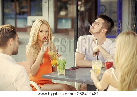 Bad Habits, Party, Addiction. Man Vapor Hookah Pipe In Shisha Bar Lounge. Women Twins And Men Friend