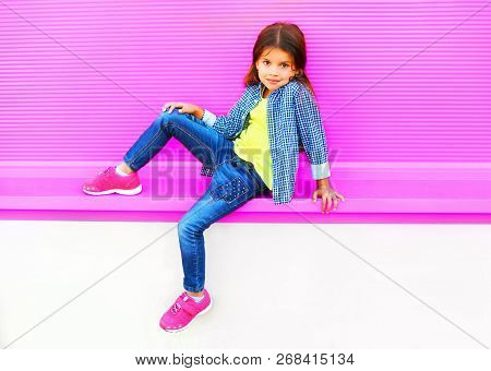 Beautiful Little Girl Child Posing On City Street On Colorful Pink Wall Background