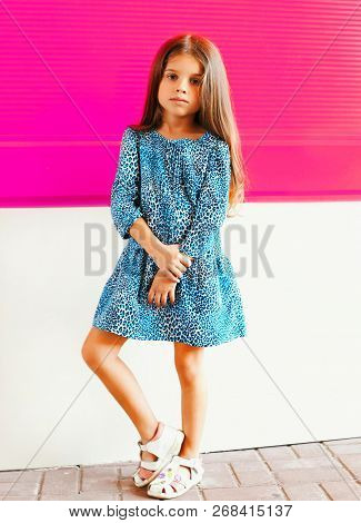 Beautiful Little Girl Child In Leopard Dress On Colorful Pink Wall Background