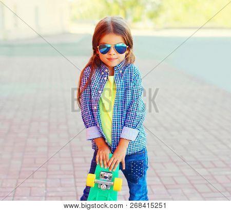 Fashion Portrait Little Girl Child With Skateboard On City Street
