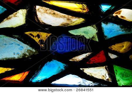 Fragment of a stained glass, closeup, background
