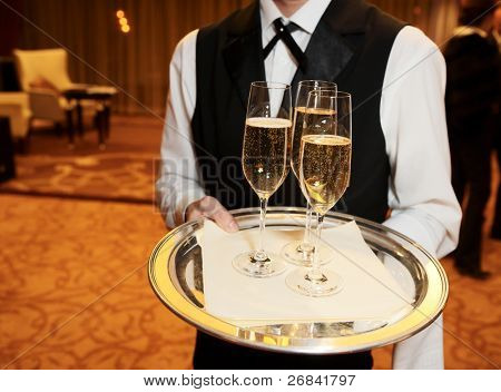 Waiter welcomes guests