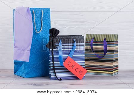 Shopping Bags Of Man With Purchases. Three Male Shopping Bags And Card With Incription Sale. Holiday