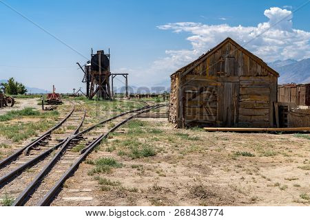 Old Abandoned Oil Well And Storage Sheds, Part Of The Former Laws Railroad In Inyo County California