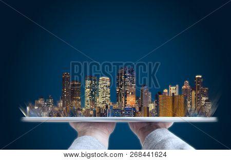 Hand Holding Digital Tablet With Modern Buildings Hologram. Building Technology, Real Estate Busines