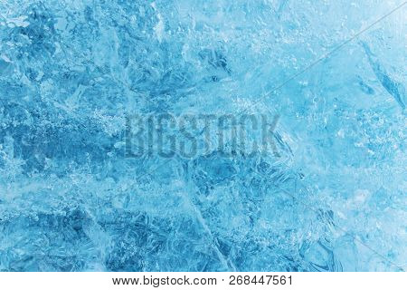 Blue ice texture, winter background, texture of ice surface, close-up.
