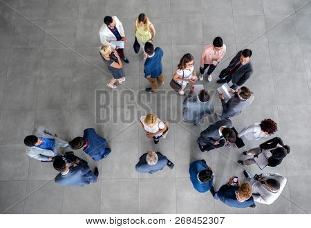 large group of people standing and talking on business meeting in the company