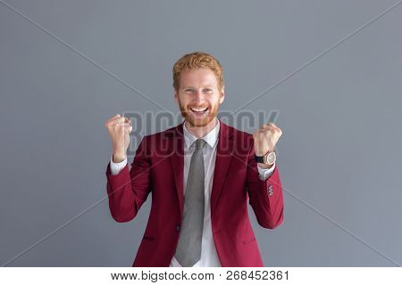 Young radiant successful happy businessman