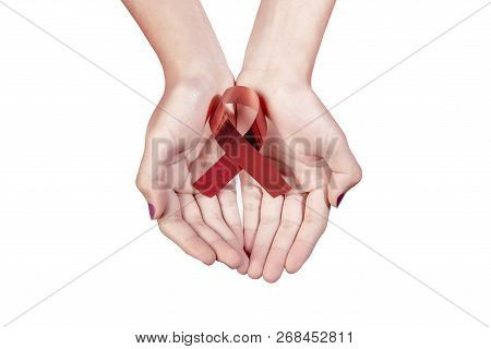 Red Ribbon Hiv Aids On Woman Hands Isolated Over White Background. World Aids Day