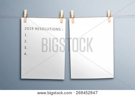 List For 2019 Resolutions In Paper Hanging On Rope. Resolutions Of 2019. Happy New Year 2019