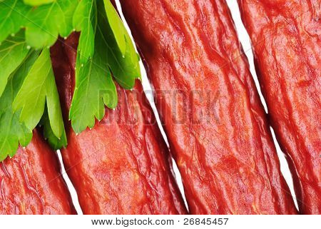 Group of tasty sausages with parsley leaf