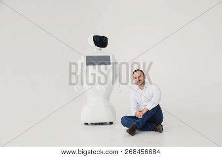 Humanoid Autonomous Robot With Stylish Man In A Suit. Modern Robotic Technologies. Humanoid Autonomo
