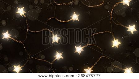 Christmas Background Made Of Lights, Garlands In The Form Of Stars In Dark Colors