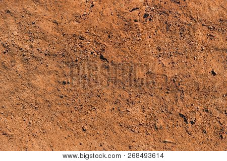 Dry Soil Texture And Background. Red Soil Background. Abstract Ground. Natural Abstraction. Clay. Oc