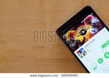Bekasi, West Java, Indonesia. November 13, 2018 : Total Conquest Dev App With Magnifying On Smartpho
