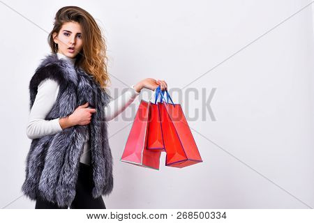 Sales And Discount On Black Friday. Girl Makeup Face Wear Fur Vest White Background. Woman Shopping