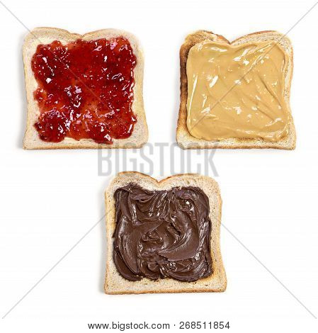 Fresh Toast Bread Or Toasted Wheat Bread Slices. Strawberry Jam, Peanut Butter And Chocolate Cream T