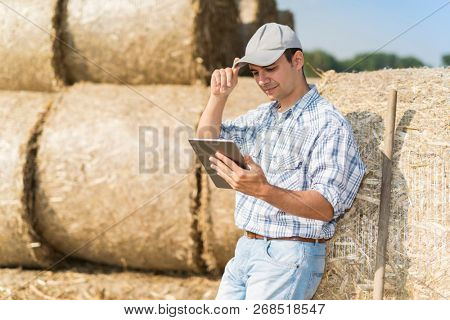 Modern farmer using his tablet
