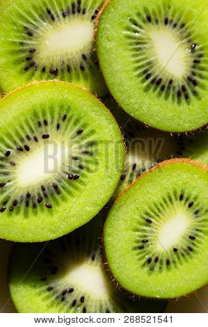 Sliced Green Fresh Kiwi Fruit Pieces Lying On Table, Flat Lay View, Healthy Diet