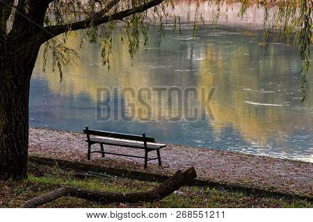 Lonely Wooden Bench Whit Gorgeous View At The River/ Beautiful Autumn River Scenery/ Place For Relax