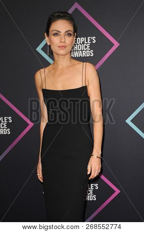 Mila Kunis at the 2018 People's Choice Awards held at the Barker Hangar in Santa Monica, USA on November 11, 2018.