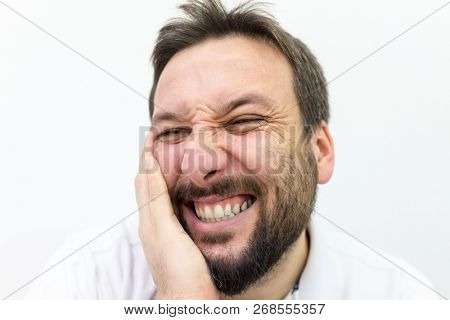 Man hiding his face as an expression of shyness poster