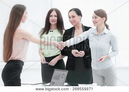 Financial Partners Shaking Hands After Successful Negotiations