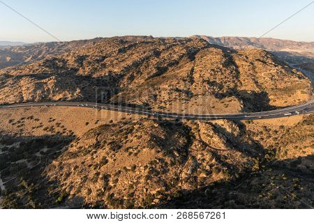 Aerial view of Route 118 freeway Santa Susana Pass near Rocky Peak, Simi Valley and the San Fernando Valley in Los Angeles, California.