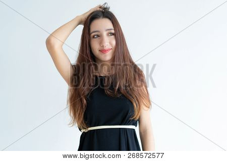 Portrait Of Smiling Young Asian Woman Scratching Head And Looking Away. Vietnamese Girl Thinking Or