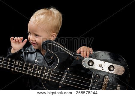 Music Festival. Rock Style Child. Little Rock Star. Child Boy With Guitar. Little Guitarist In Rocke