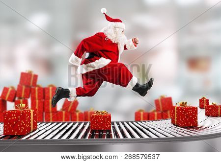 Santa Claus Runs On The Conveyor Belt To Arrange Deliveries At Christmas Time