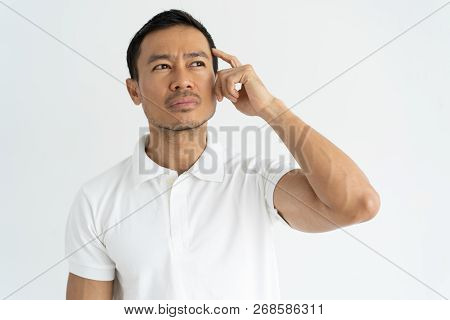 Pensive Young Businessman Thinking Over Business Project. Handsome Latin Man Scratching Head And Sta