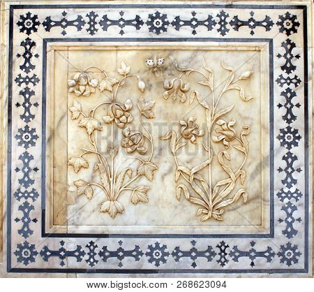 Ancient carved flower on marble in Amber Fort near Jaipur, Rajasthan, India