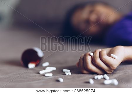 young woman committing suicide by overdosing on medication poster