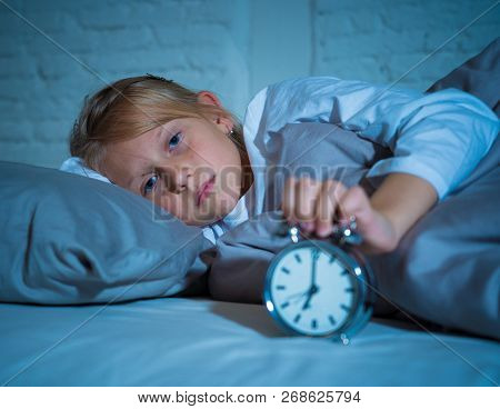 Cute Girl Waking With Alarm Clock Feeling Tired And Angry Time To Go To School Early In The Morning