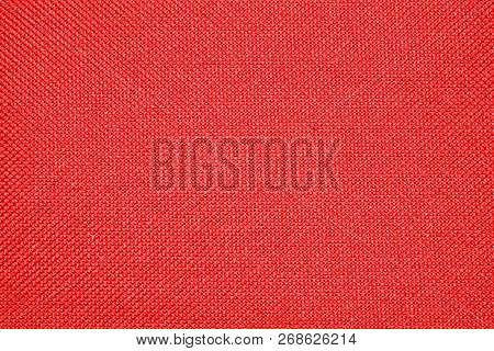 Red texture of binding fabric.Red fabric background.Red cloth. Background with textured surface. poster