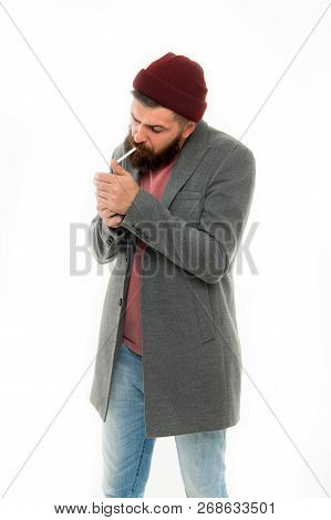 Man Brutal Bearded Hipster Dressed As Vagabond Smoking Cigarette. Brutal Unshaven Guy Smoking Isolat