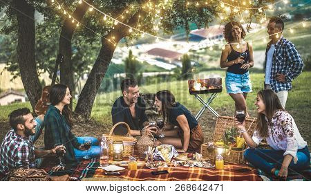 Happy Friends Having Fun At Vineyard After Sunset - Young People Millennial Camping At Open Air Picn