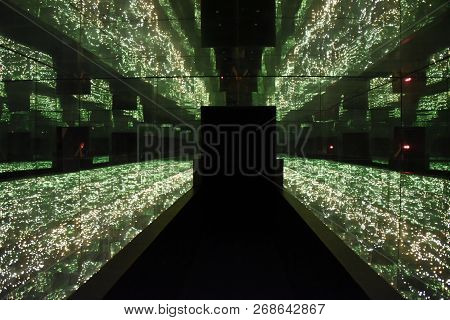 Infinity Room Of Lights And Mirrors Surrounding A Hallway With Doorway At The Far End, Creating The