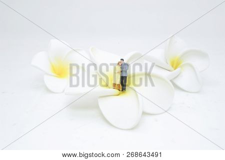 A Figure Of Couple Standing On Flower